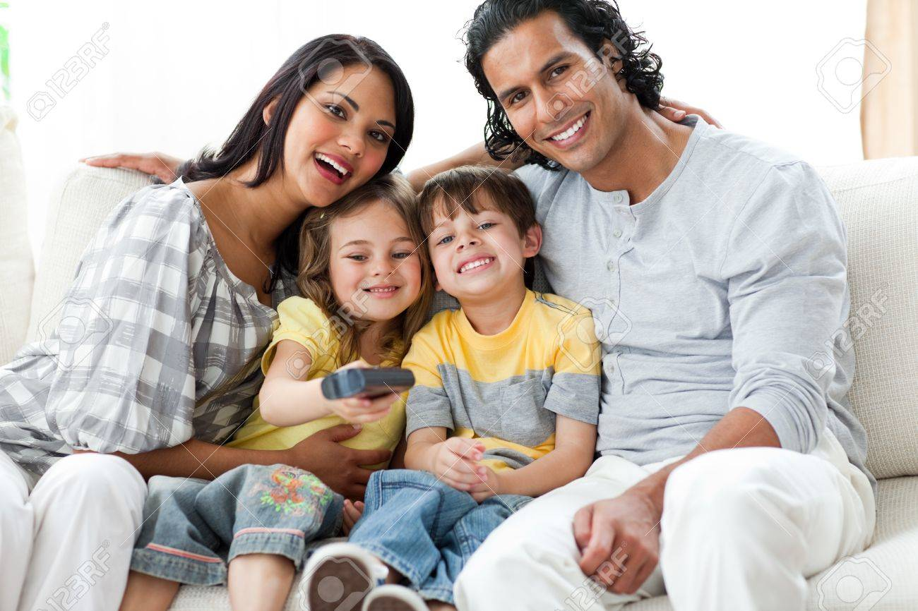 Happy family watching TV  together sitting Stock Photo - 10107470