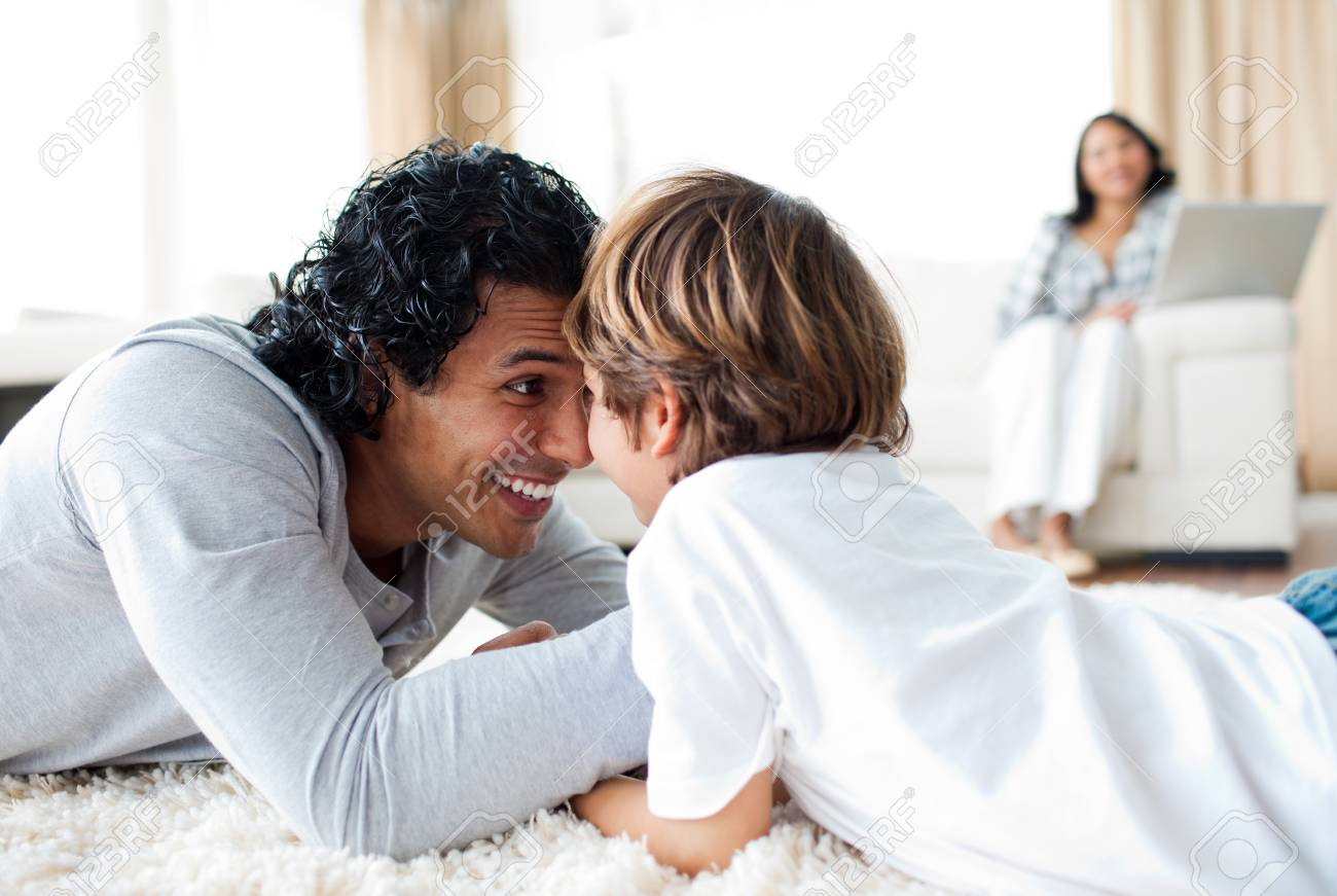 Jolly father and his son armwrestling Stock Photo - 10106975