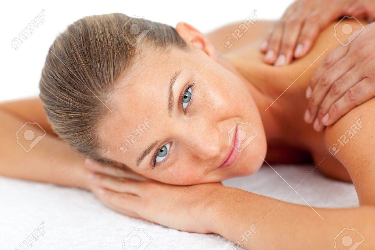 Portrait of blond woman enjoying a massage Stock Photo - 10107292