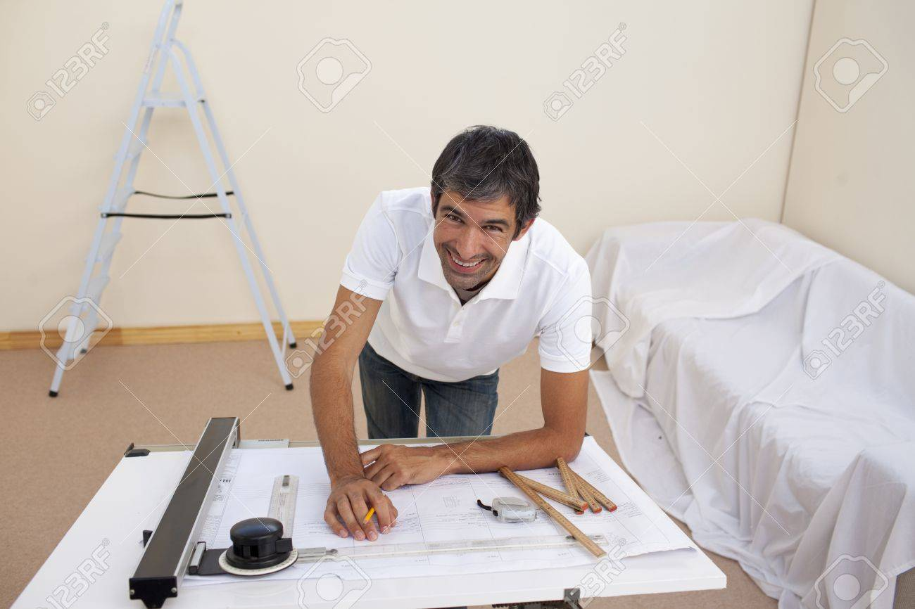 Smiling architect man decorating a bedroom Stock Photo - 10112172