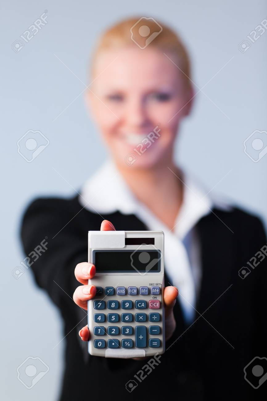 Business woman holding calculator Stock Photo - 10112437