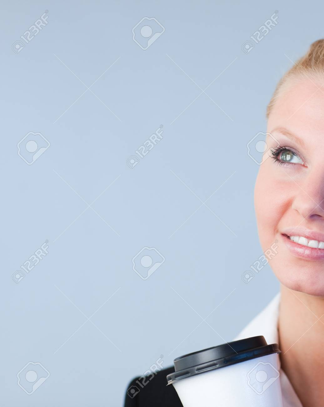 Woman holding a take away coffee container Stock Photo - 10109623
