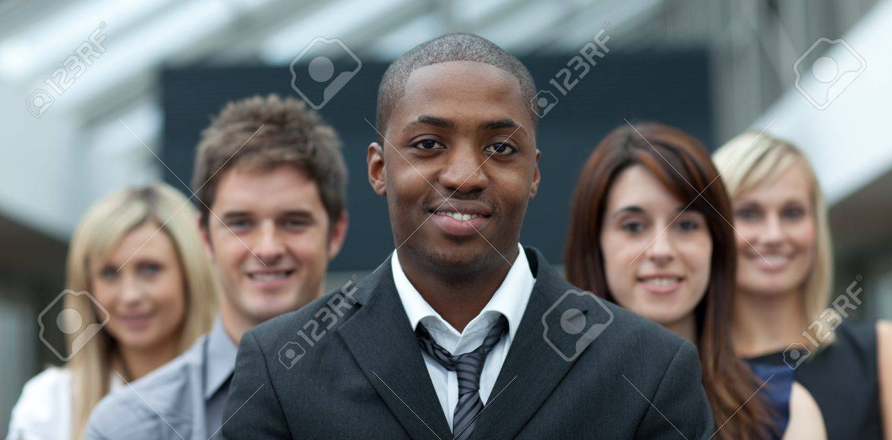 Afro-American businessman smiling at the camera with his team Stock Photo - 10111953