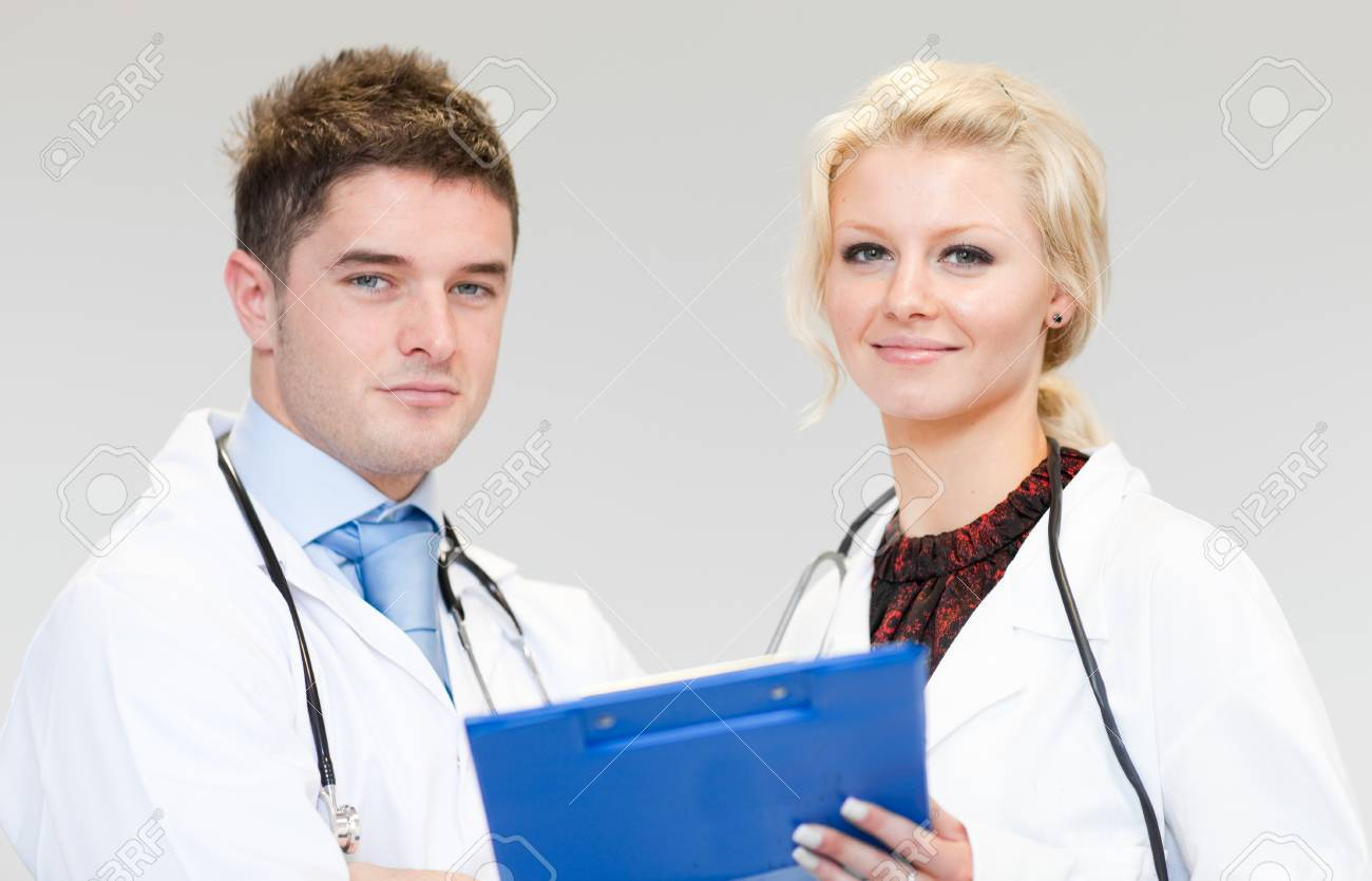 Two happy surgeons working together Stock Photo - 10110337