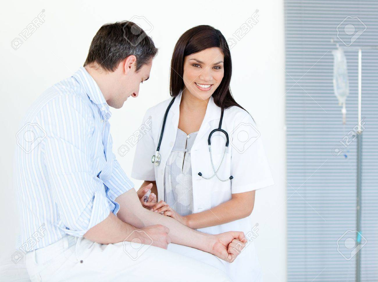 Smiling female doctor making injection to her patient Stock Photo - 10110154