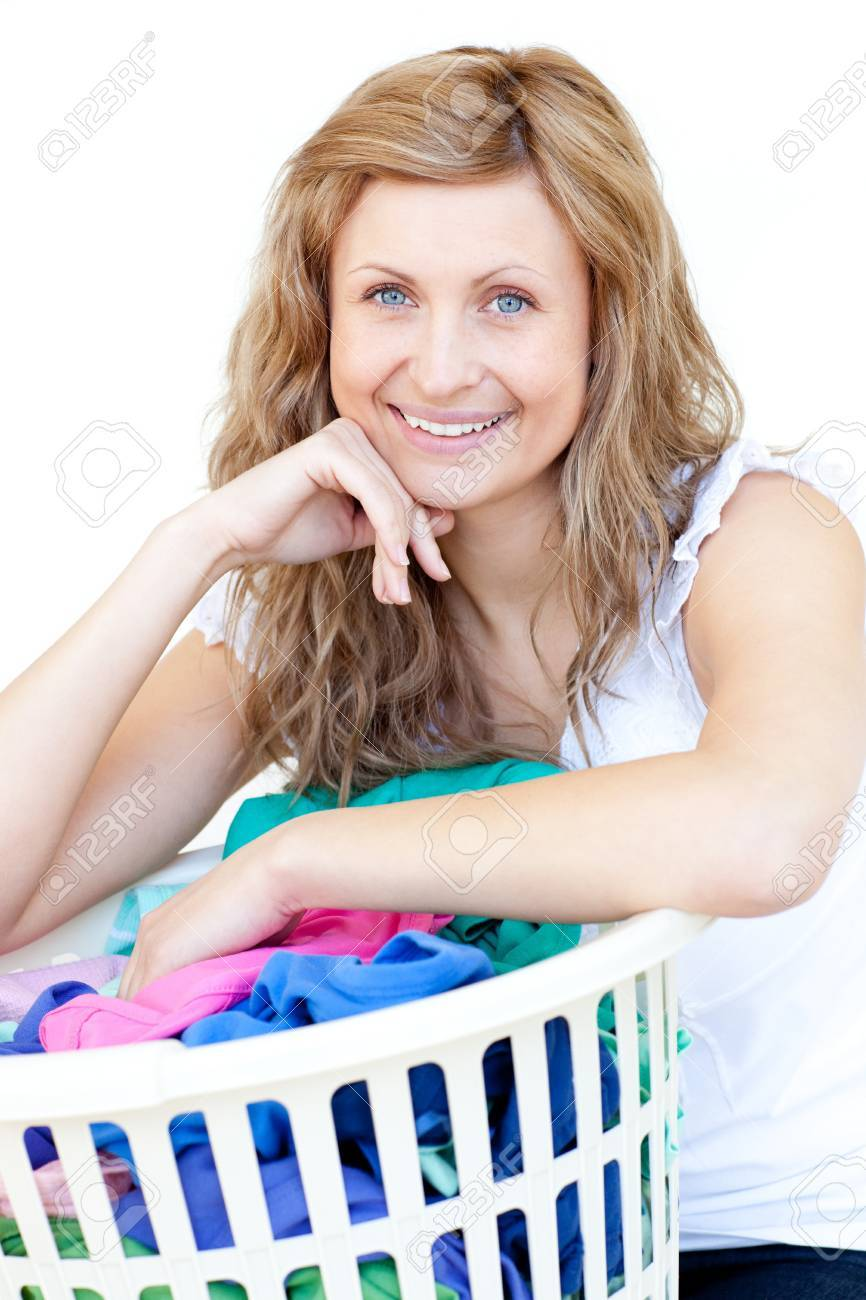 Happy woman doing laundry against a white background Stock Photo - 10109306