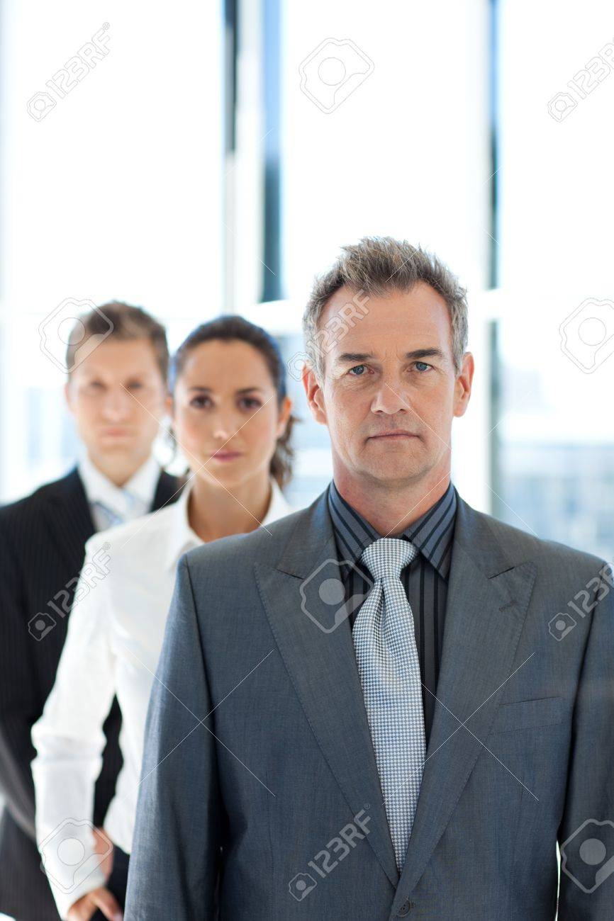 Businessman leading a business team in a row Stock Photo - 10128794