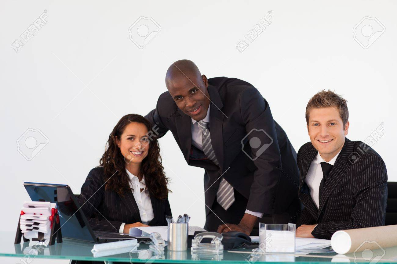 Business team in an office smiling at the camera Stock Photo - 10114875