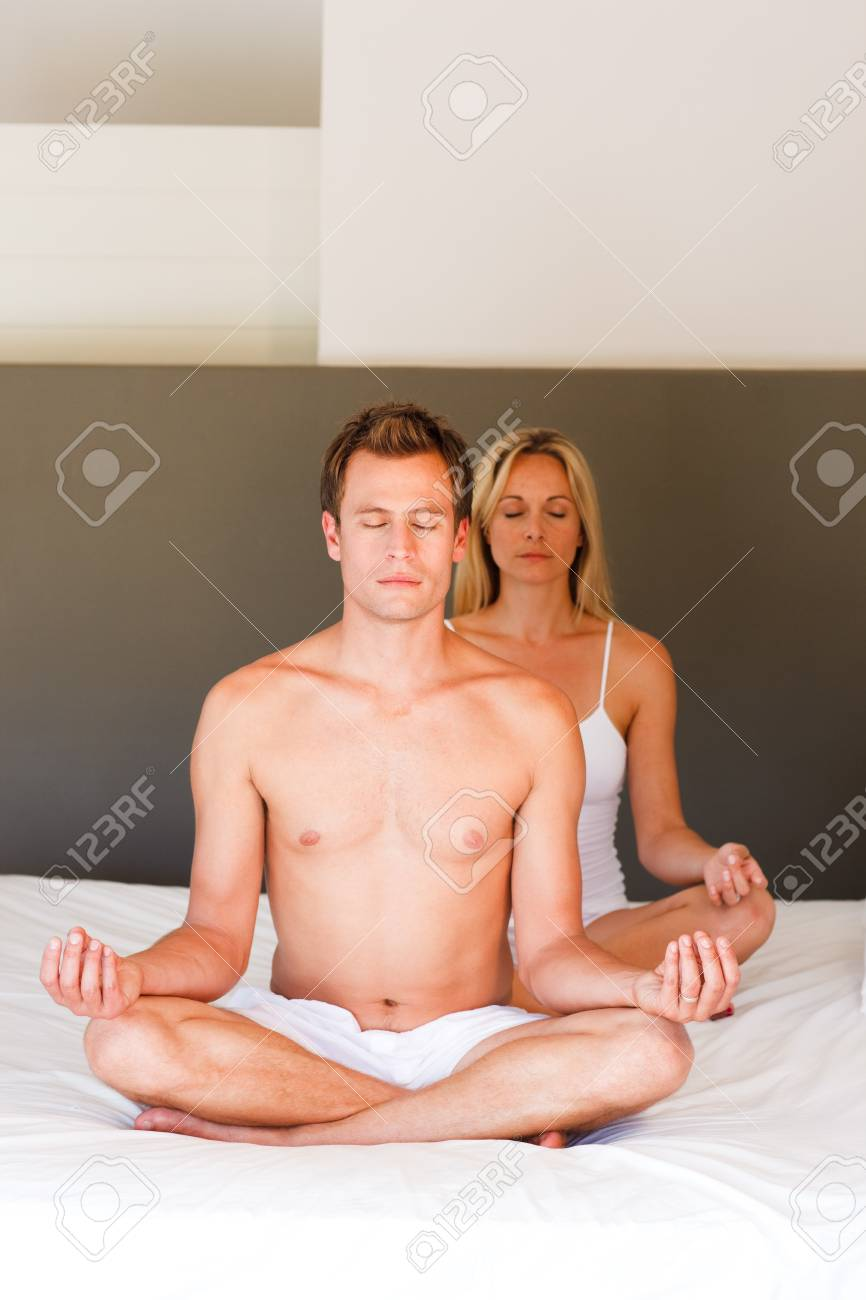 Couple doing exercises on bed with copy-space Stock Photo - 10115106