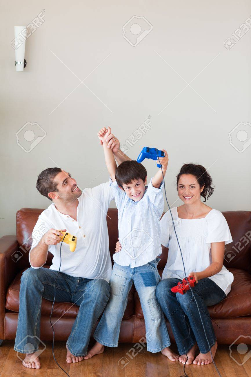 Loving family playing video games in the living-room Stock Photo - 10128499