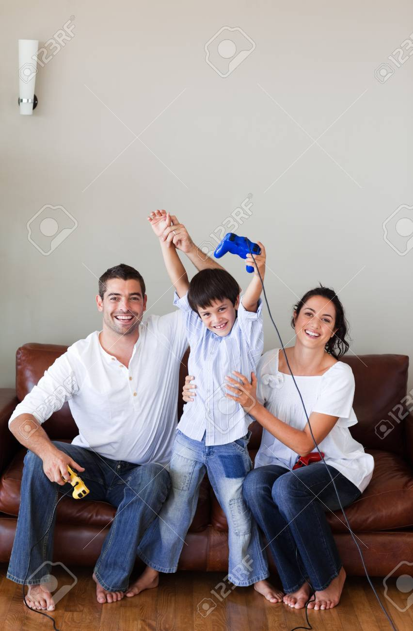 Bright family playing video games in the living-room Stock Photo - 10129509