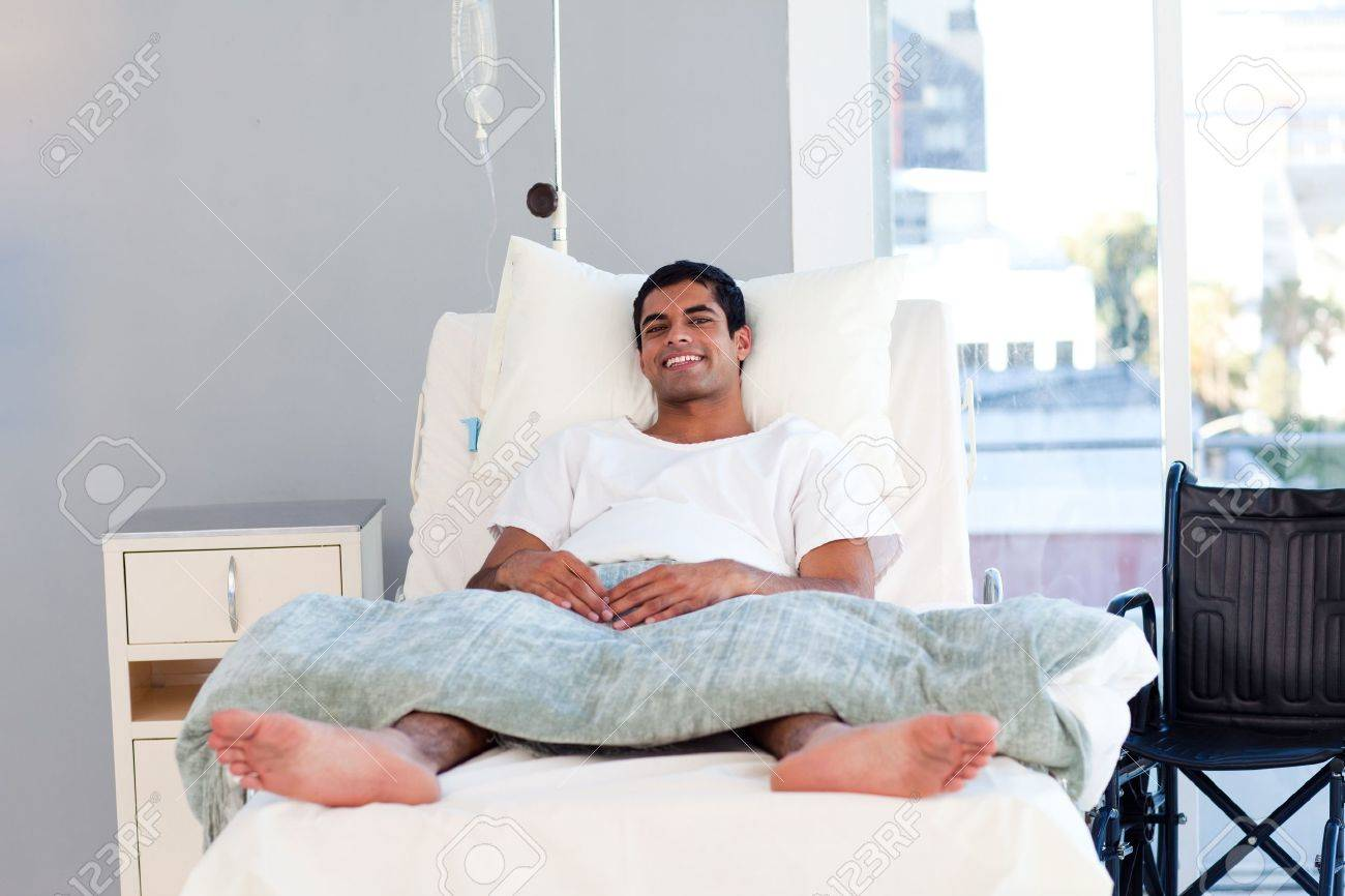 Hispanic patient in bed smiling at the camera Stock Photo - 10114933