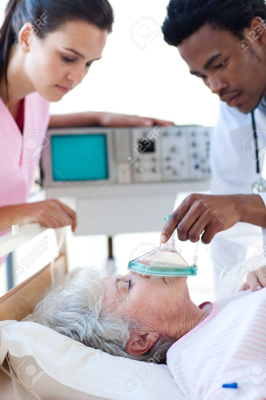 Medical team resuscitating a senior patient Stock Photo - 10114989