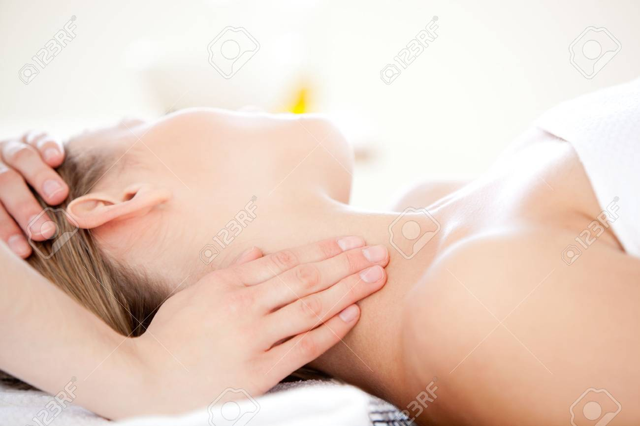 Close-up of a caucasian woman receiving a head massage Stock Photo - 10114255