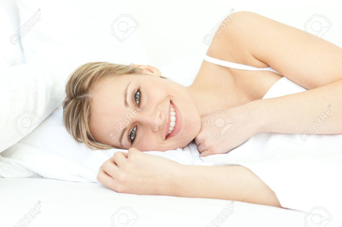 Jolly woman relaxing lying on a bed Stock Photo - 10113984