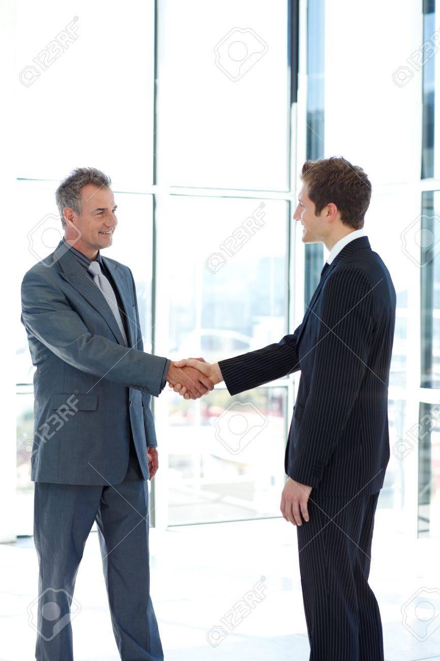 [Image: 10114225-businessmen-shaking-hands.jpg]