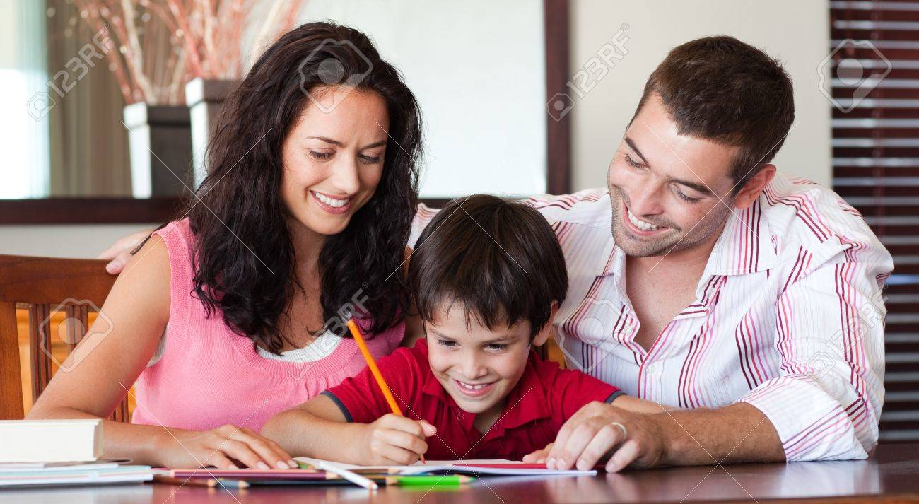 Radiant couple helping his son for homework Stock Photo - 10114268