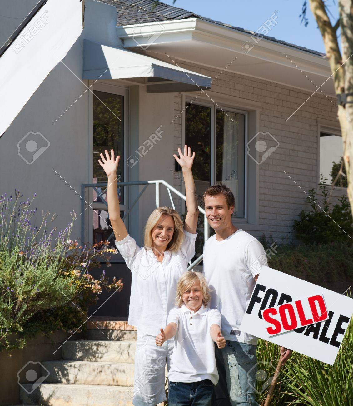 Father, mother and son in front of their new house Stock Photo - 10133694
