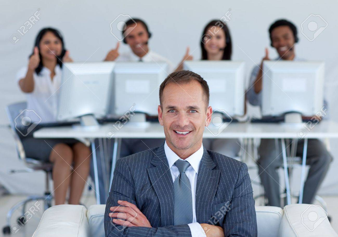 Manager in call center with his team with thumbs up Stock Photo - 10133354