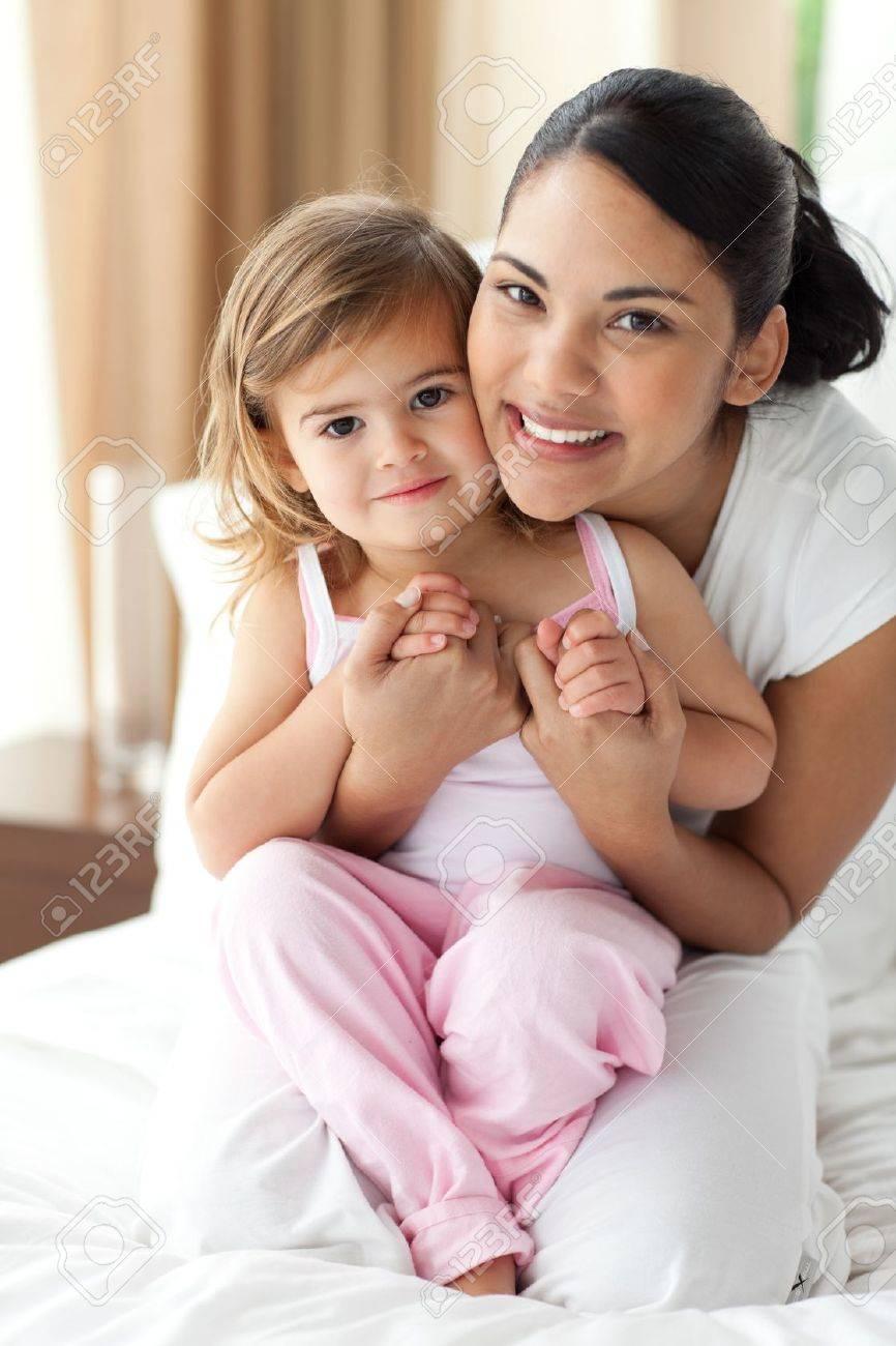 Smiling mother hugging her little girl Stock Photo - 10134149