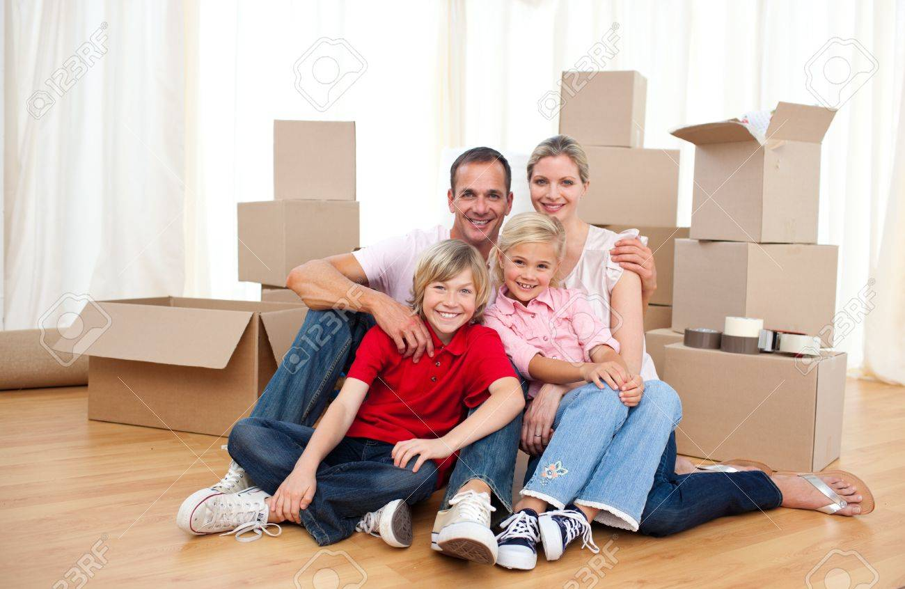 Smiling family relaxing sitting on the floor Stock Photo - 10133916