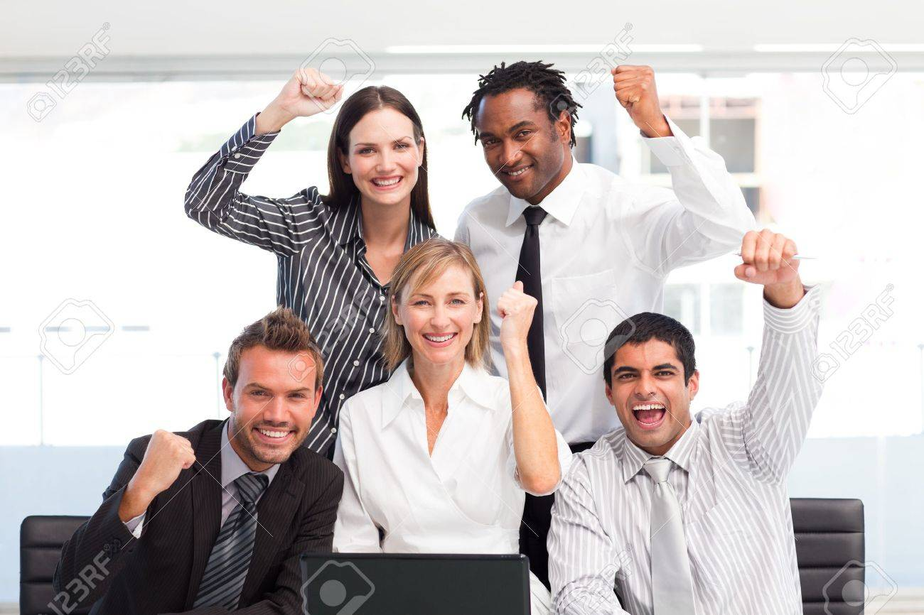 Happy Business Team Celebrating A Success In Office Stock Photo Picture And Royalty Free Image Image 10130972