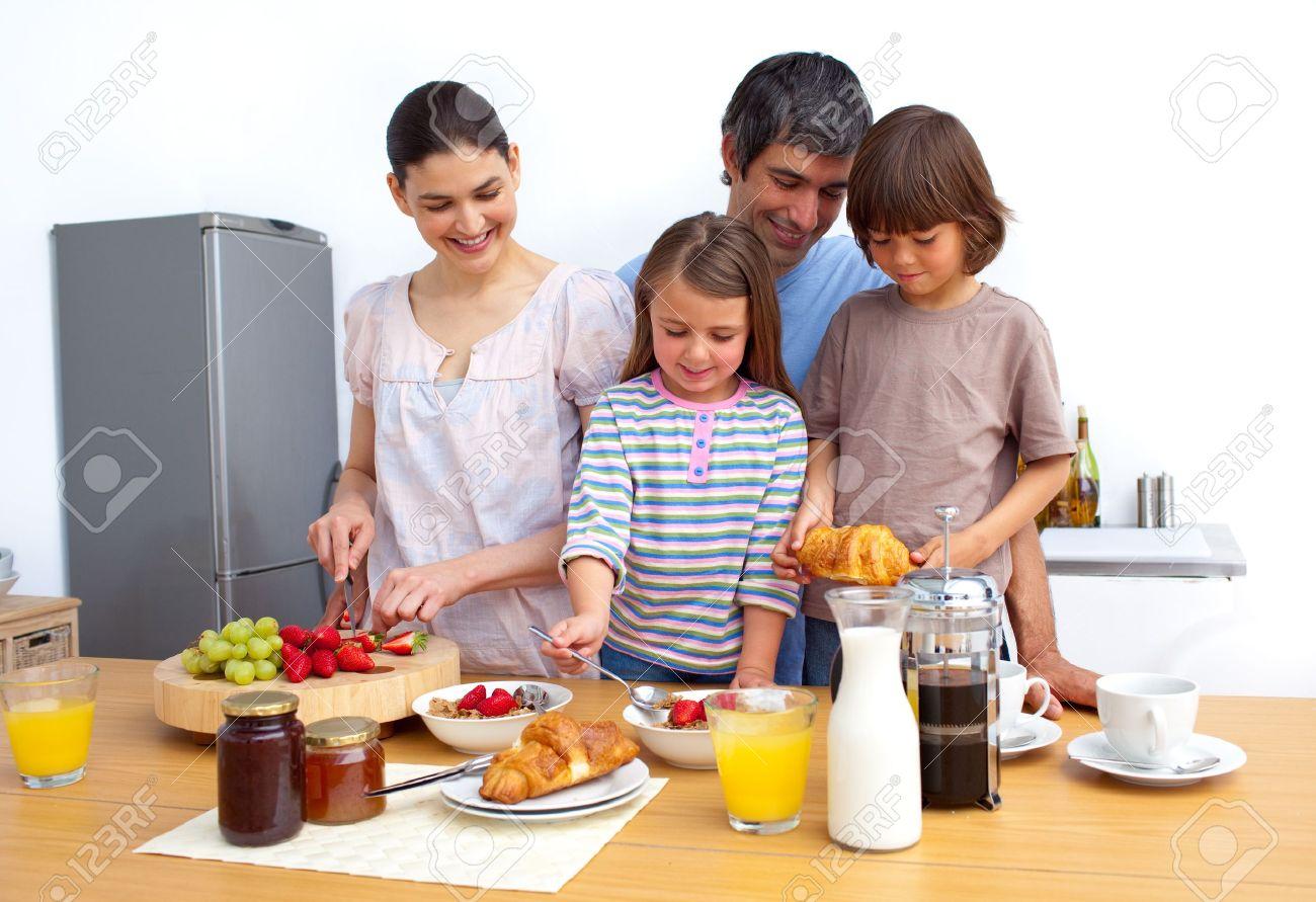 Cheerful family having a breakfast - 10134163