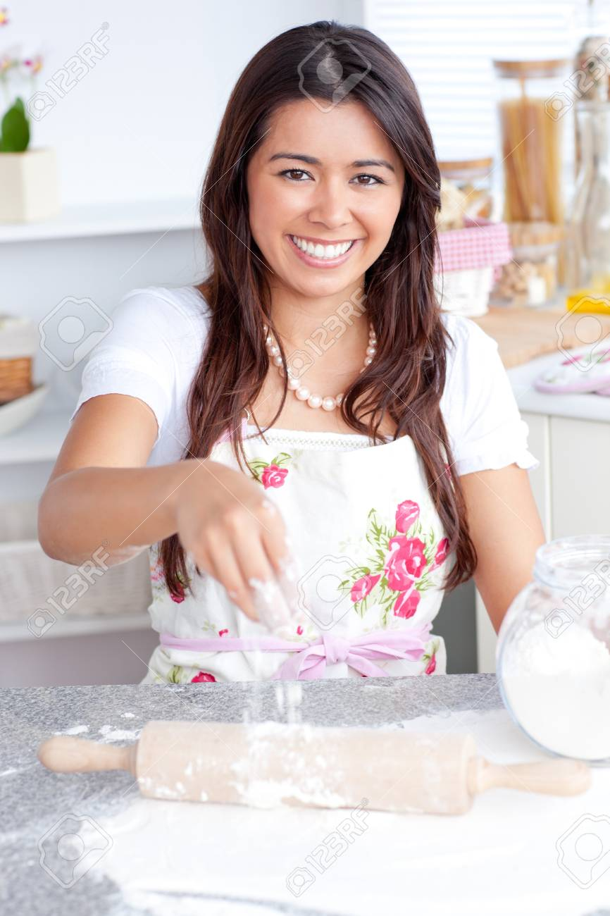 Captivating asian woman baking in her kitchen Stock Photo - 10131155