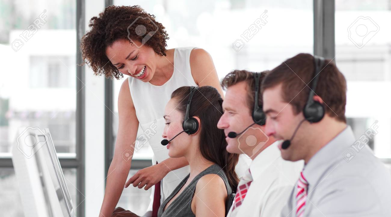 Delighted female manager with her sale representative team Stock Photo - 10135208