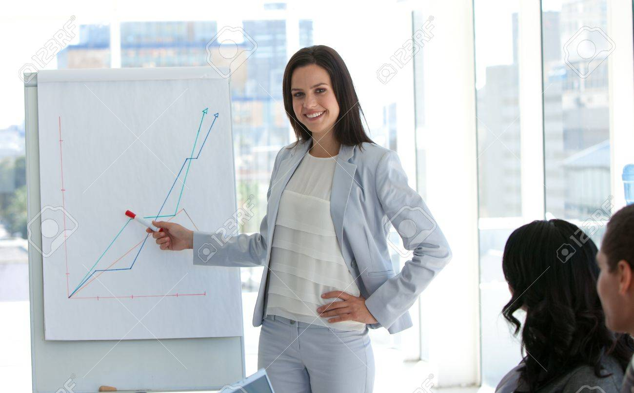 Businesswoman reporting to sales figures Stock Photo - 10135833