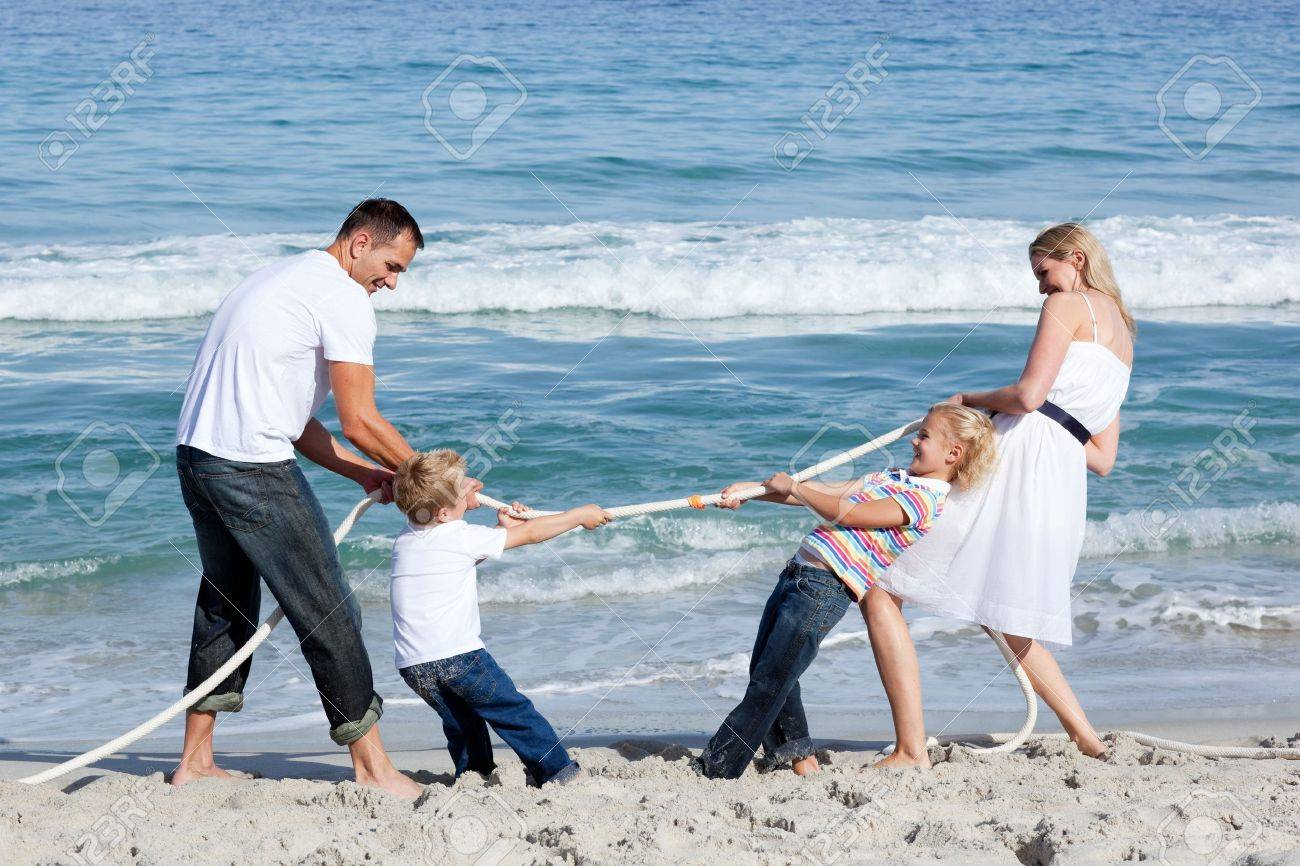 Excited family playing tug of war Stock Photo - 10175846