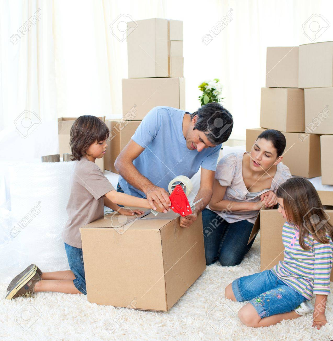 Jolly Family moving house Stock Photo - 10162274