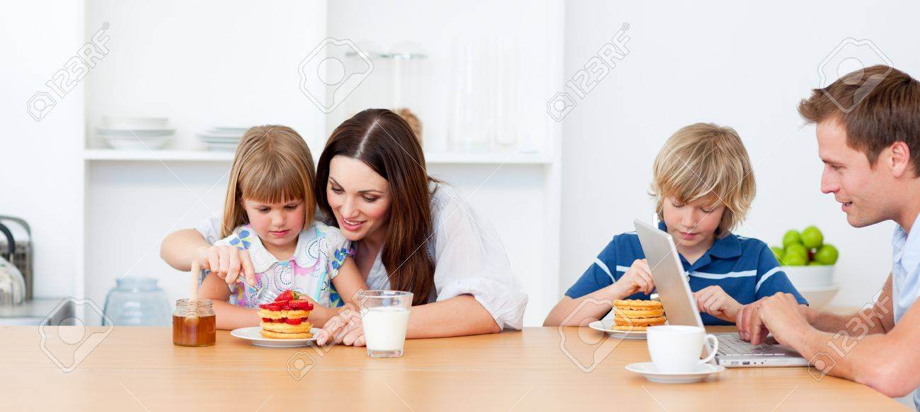 happy family eating breakfast in the kitchen stock photo, picture,