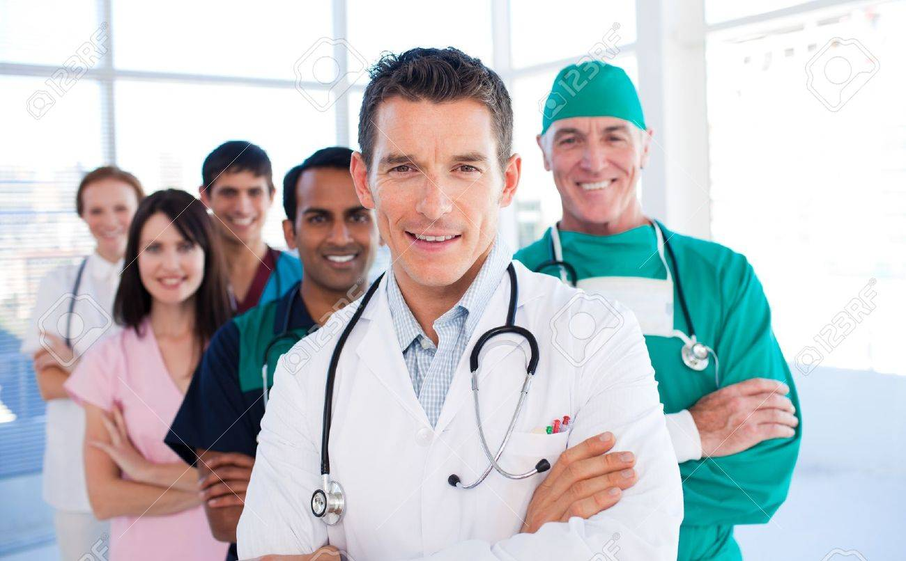 Atractive doctor standing with his colleagues Stock Photo - 10162984