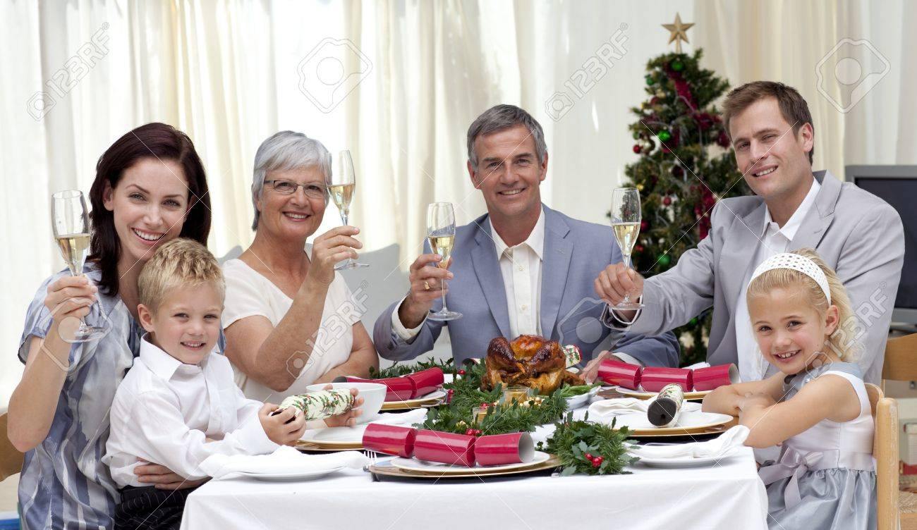 Family tusting in a Christmas dinner with white wine Stock Photo - 10163573