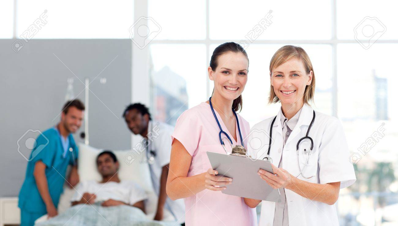 Attractive doctors attending to a patient Stock Photo - 10137360