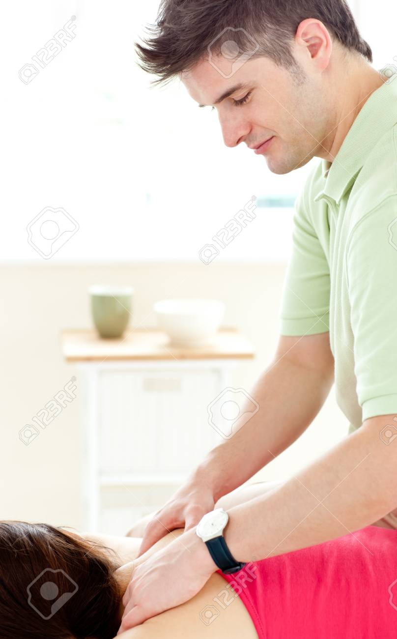 Young man doing fitness exercises with a female patient Stock Photo - 10162507