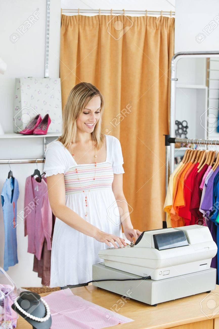 Elegant saleswoman standing at the cash register Stock Photo - 10175900