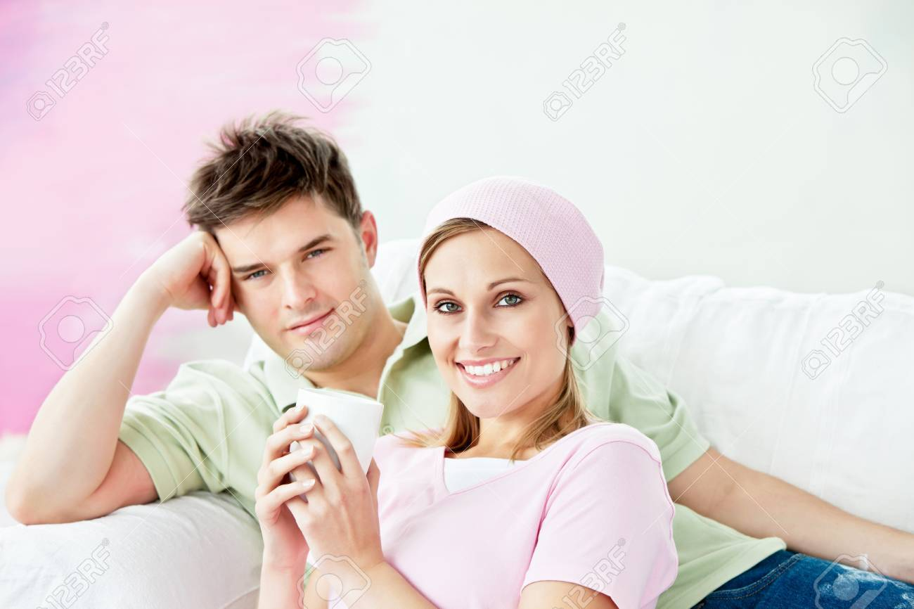 Relaxing couple lying on a sofa after painting a room Stock Photo - 10172205