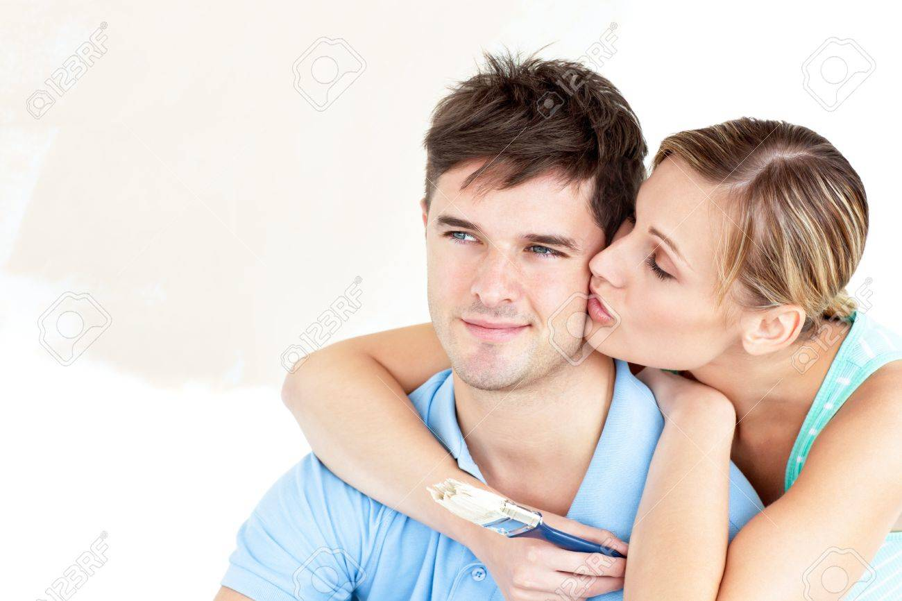 Hugging caucasian couple painting a room Stock Photo - 10163744