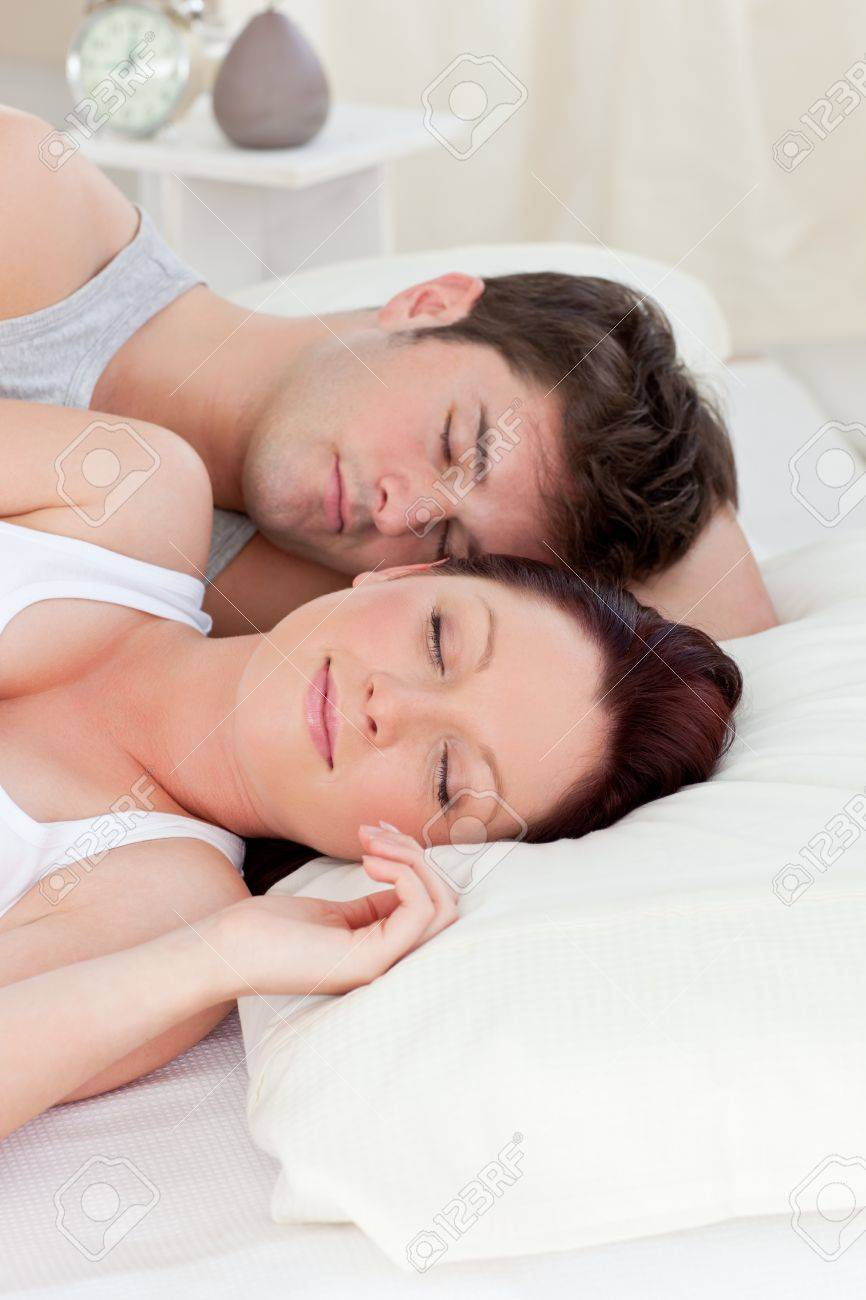 Young caucasian couple sleeping in bed Stock Photo - 10164166