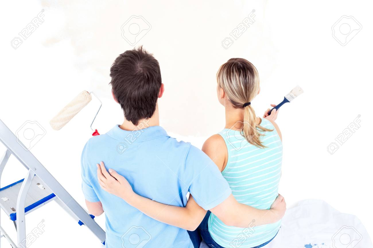 Affectionate couple painting a room Stock Photo - 10163981