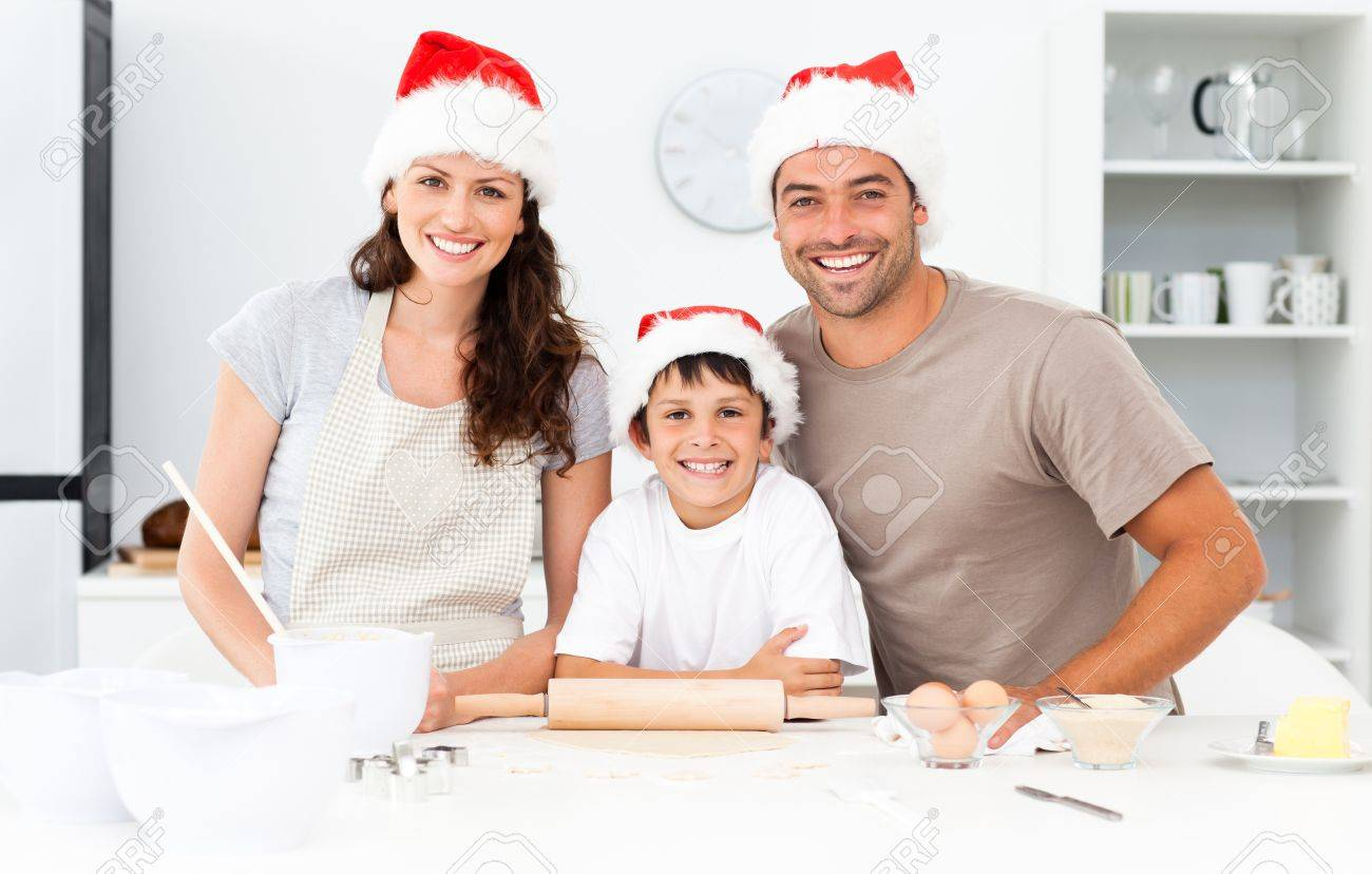 Portrait of a happy family preparing christmas cookies Stock Photo - 10171405