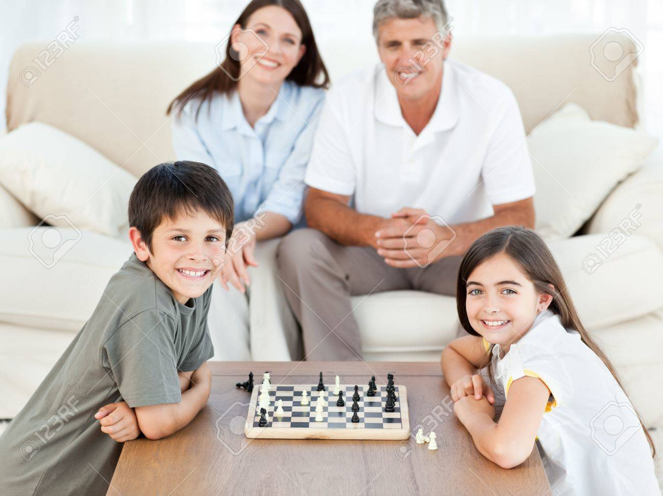 Portrait of a little family in their living room Stock Photo - 10169898