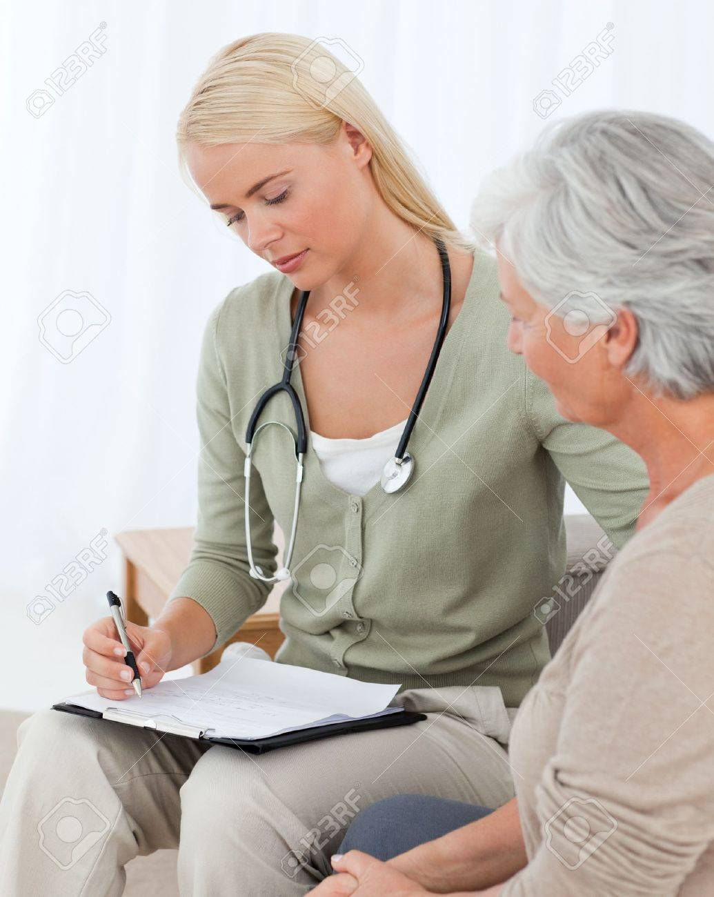 Doctor talking with her patient Stock Photo - 10172156