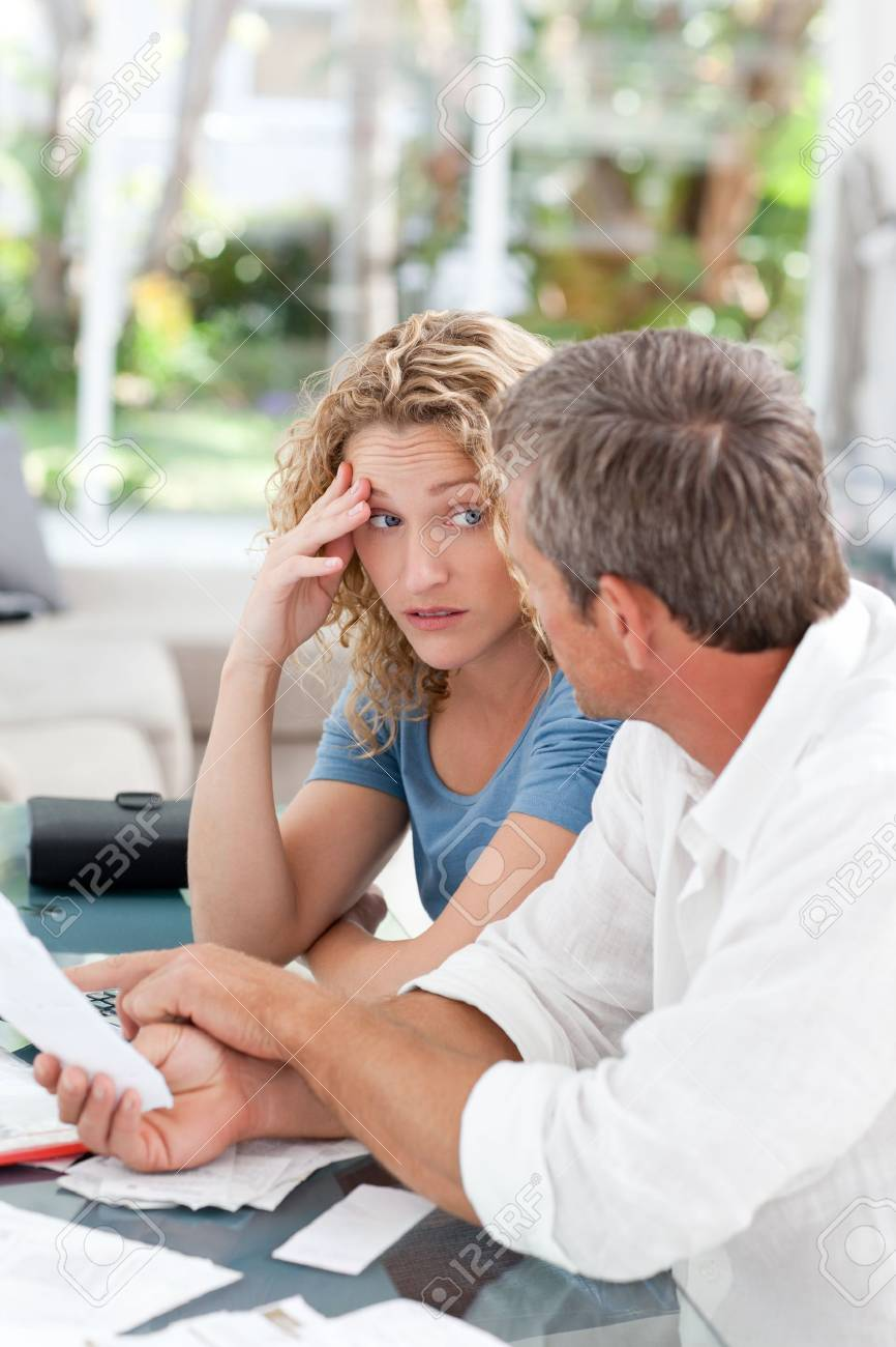 Desperate couple calculating their domestic bills at home Stock Photo - 10171005