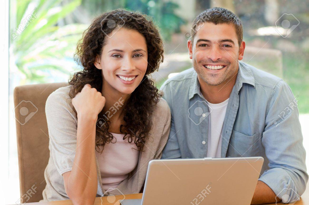 Young couple calculating their domestic bills at home Stock Photo - 10174453