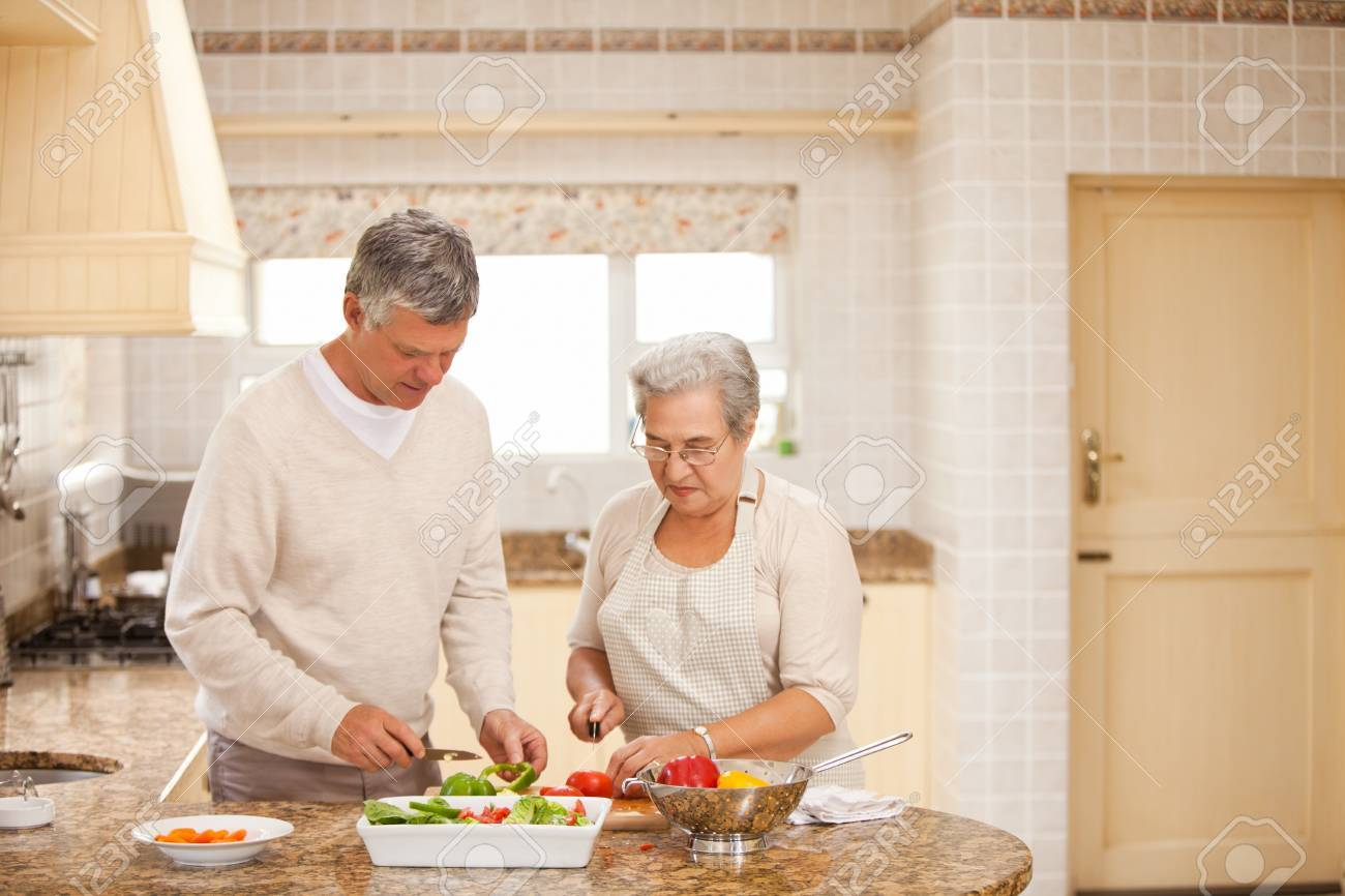 Senior couple cooking in the kitchen Stock Photo - 10170491