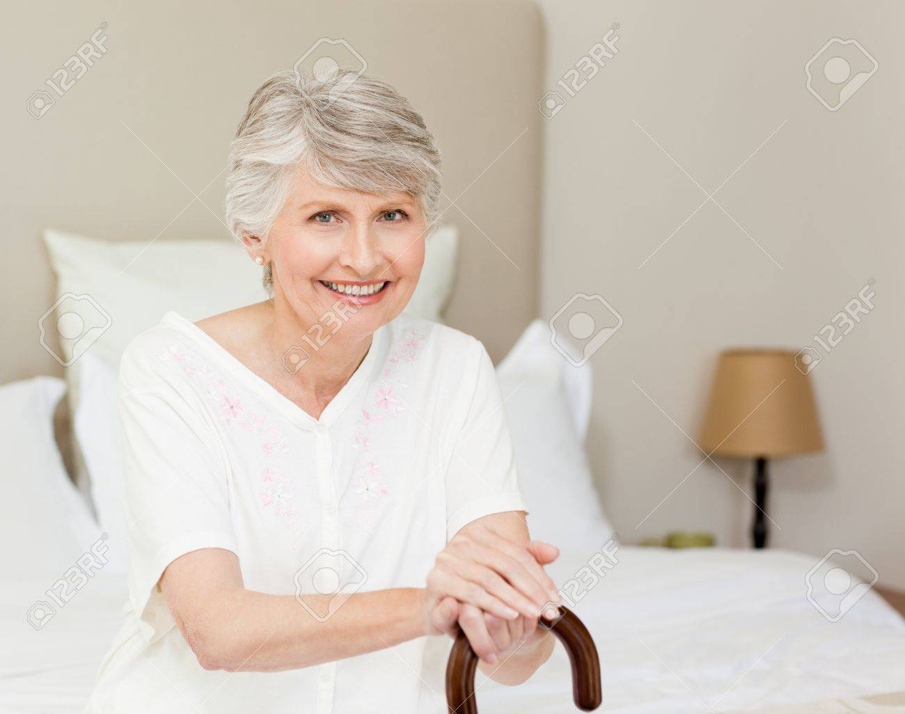 Retired woman with her walking stick Stock Photo - 10170861