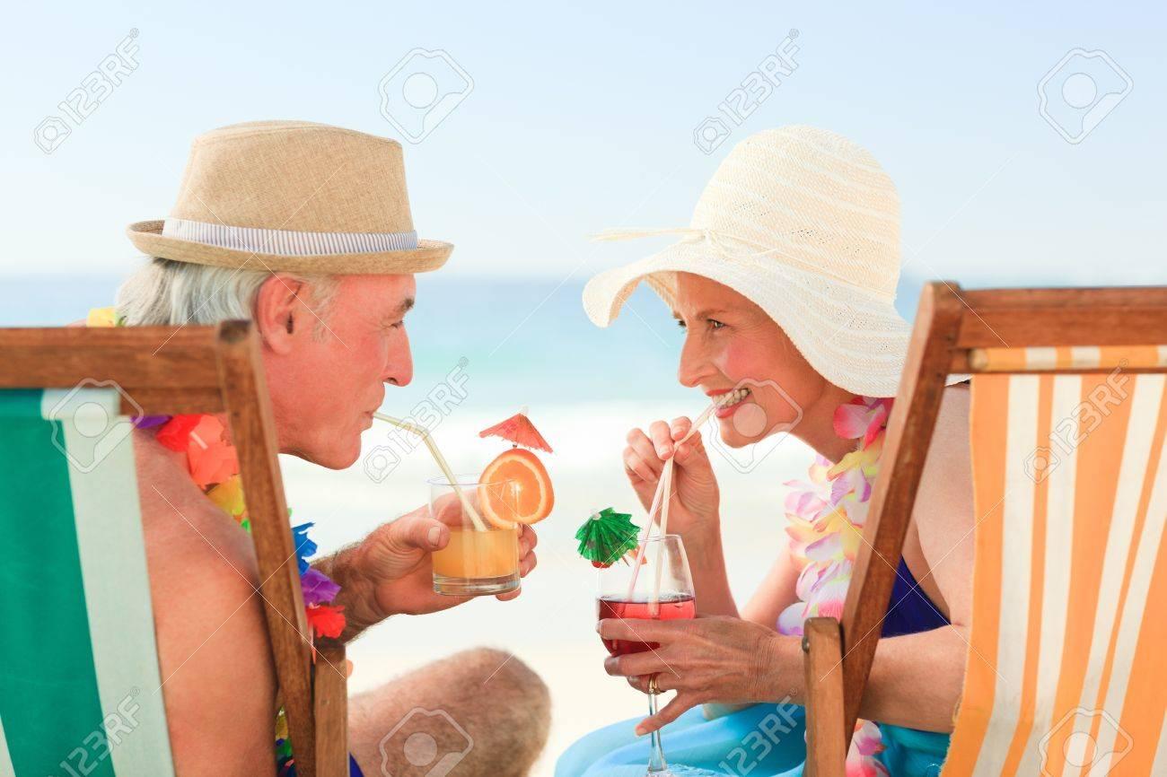 Happy senior couple drinking a cocktail Stock Photo - 10170497